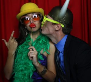 Girl and Boy having fun in Photo Booth